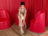 Anna in red room